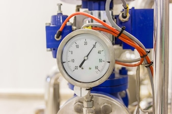 Closeup of pressure gauge, pressure gauge for monitor condition. Pipes and valves