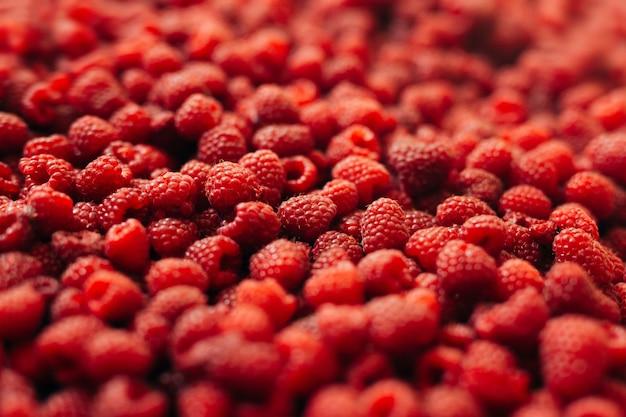 Крупный план красных спелых ягод малины фона и текстуры