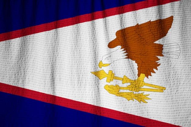 뻗 치고 미국령 사모아 깃발, 바람에 날리는 미국령 사모아 깃발의 근접 촬영