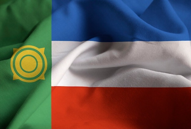 Макрофотография флага раффл-хакасия, флаг хакасии, дующий в ветру