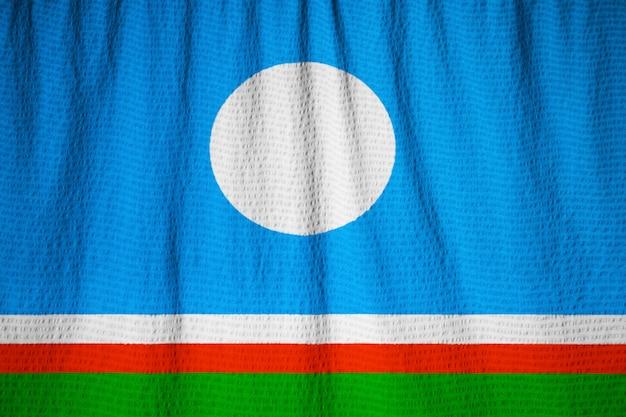 Макрофотография флага флаг раффл-саха, флаг республики саха, дующий в ветру