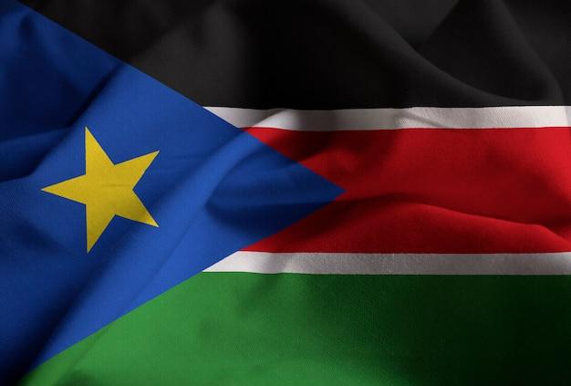 Макрофотография ruffled sudan южный флаг, судан южный флаг, дует в ветре