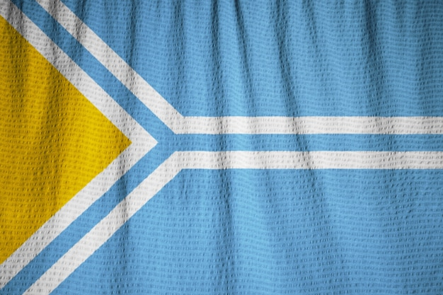 Макрофотография фальшивого флага тувы, флажок тувы, дующий в ветре