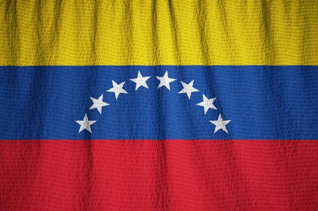 Макрофотография флагов ruffled венесуэлы, венесуэльский флаг, дующий в ветру