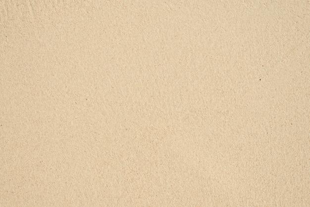 夏のビーチの砂のパターンのクローズアップ。ビーチの背景。上面図
