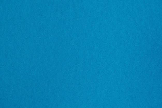 배경 또는 삽화에 대한 원활한 파란색 종이 질감의 근접 촬영