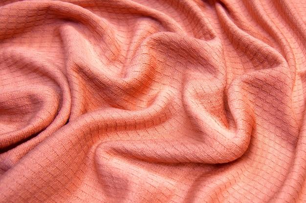 Крупным планом текстуры бесшовные розовой трикотажной ткани