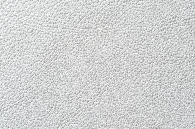背景のシームレスな白い革のテクスチャのクローズアップ