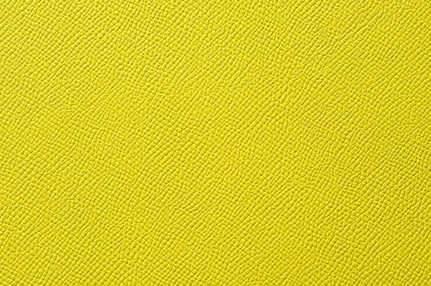 배경 원활한 노란색 가죽 질감의 근접 촬영