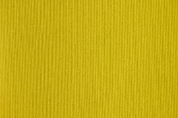 배경 또는 삽화에 대한 원활한 노란색 종이 질감의 근접 촬영