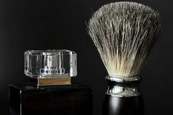 Closeup of shaving brush and perfume