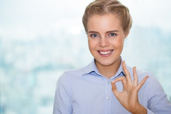 Closeup of Smiling Pretty Woman Showing OK Sign