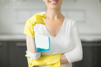 Closeup of smiling young woman at the kitchen