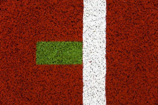 Крупный план беговой дорожки красного стадиона