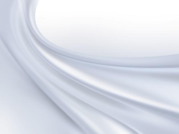 배경으로 흰색 실크 직물의 근접 촬영