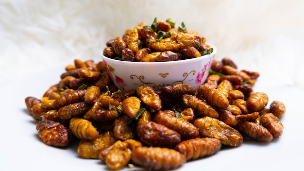 Closeup oily taste and salty silkworms insect food worm insect for eating