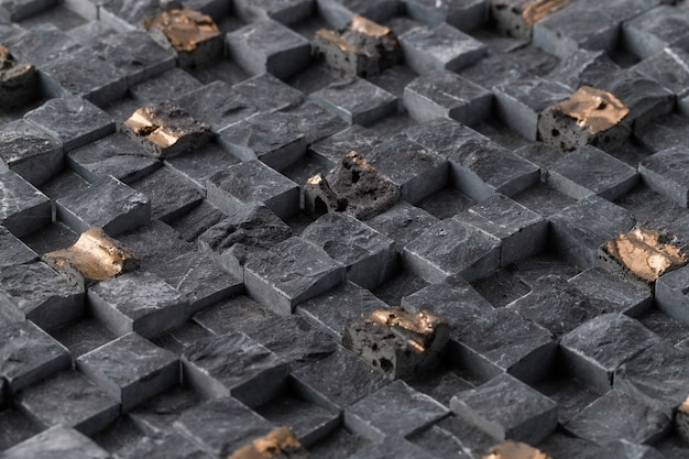Primo piano di vecchie piastrelle quadrate nere di un muro sotto le luci - fresco per gli sfondi