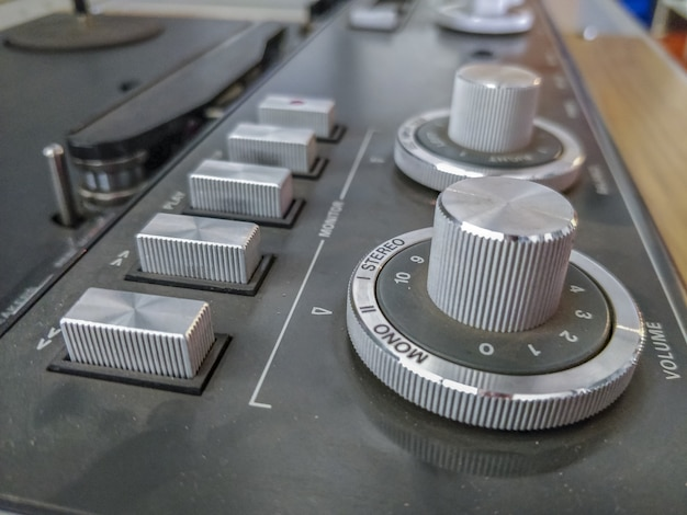 Closeup of an old dusty cdj on the table with a blurred background