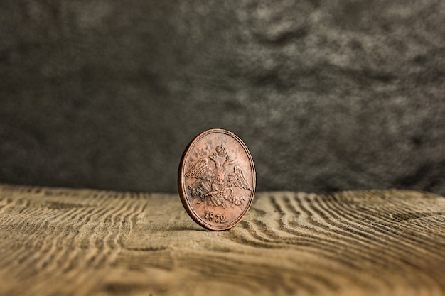 Closeup of old russian coin on a wooden table.