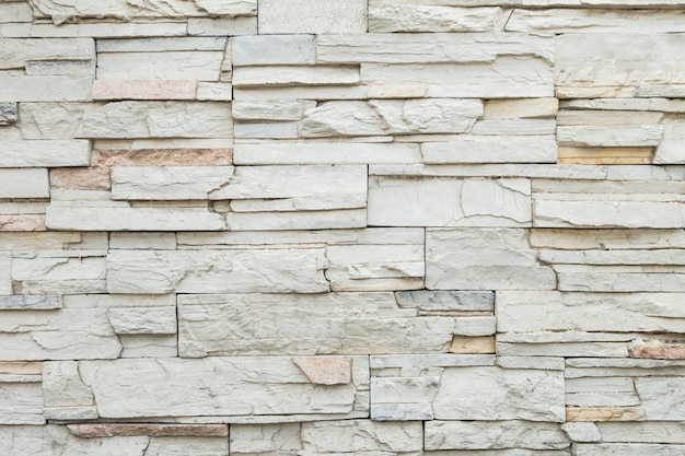 Closeup old stone brick wall texture background