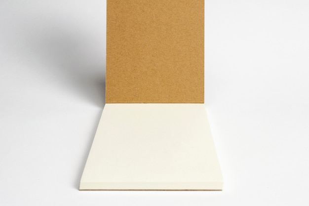 Closeup of opened diary with cardboard hardcover and blank pages isolated on white.