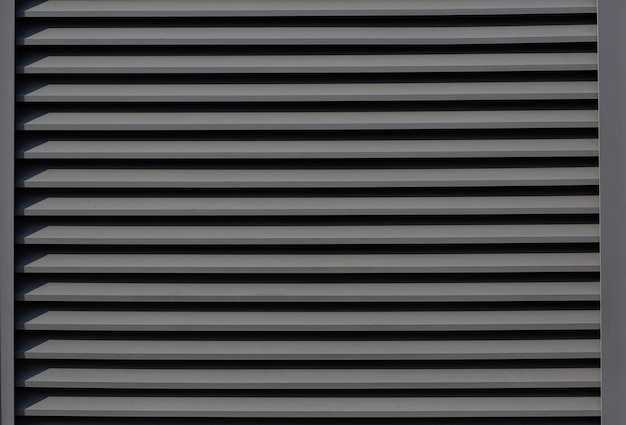 Closeup outdoor shot of roller metal shutters with shadows