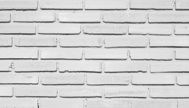 Closeup outside building exterior gray brick cement wall background texture for design concept