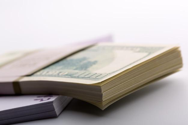 Closeup of packs of dollars and euros