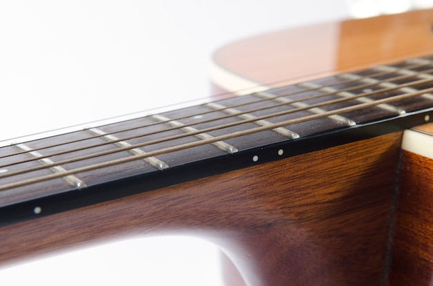 Closeup to a part of guitar, isolated on white