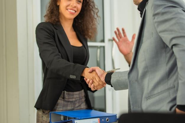 Closeup people hands shake business partnership success, shake hand concept