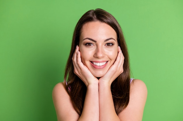 Closeup photo adorable vogue lady shiny smile palms face look camera posing photographer happy advert dental clinic service straight hair cover clothes isolated pastel green color background