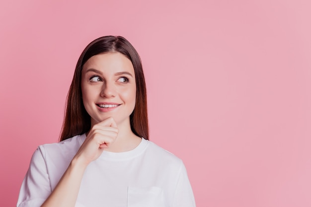 Closeup photo of attractive person look empty space finger chin on pink background