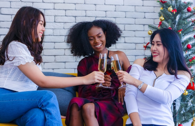 Closeup photo of cheerful girls celebrating a party at home with campaign.