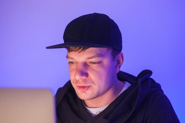 Closeup photo handsome man working on laptop
