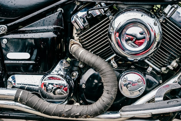 Closeup  photo of motorbike engine with lots of chrome details. modern powerful perfomance road motorcycle  with exhaust pipes.  chopper motor.