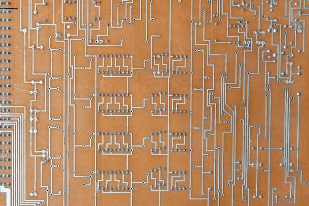 コンピュータ回路基板の背景テクスチャ抽象のクローズアップ写真