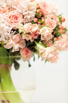 Closeup photo of pastel pink flowers against white