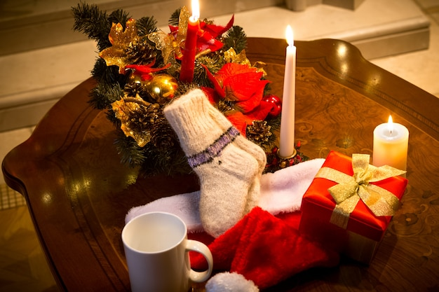 Closeup photo of table decorated with candles, and christmas decorations