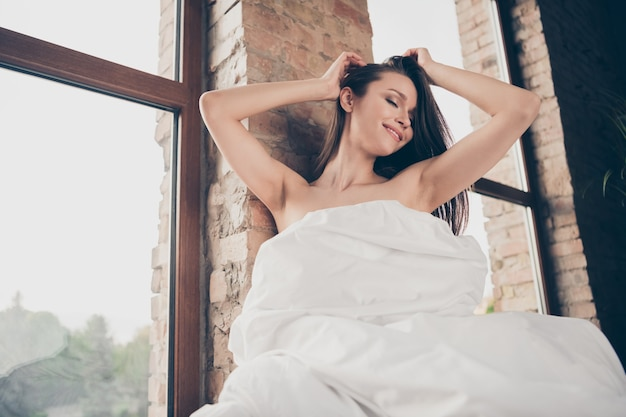 Closeup photo of tender seductive lady quarantine stay home covered white blanket naked shoulders sensual notebook undressing boyfriend video call touch head teasing sit near window indoors
