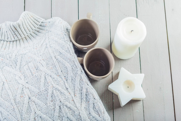 Closeup photo of warm sweater with mug