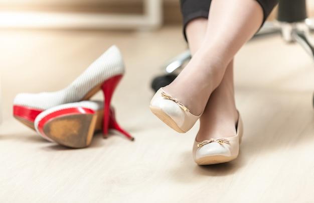 Closeup photo of woman wearing ballet flats instead of high heels