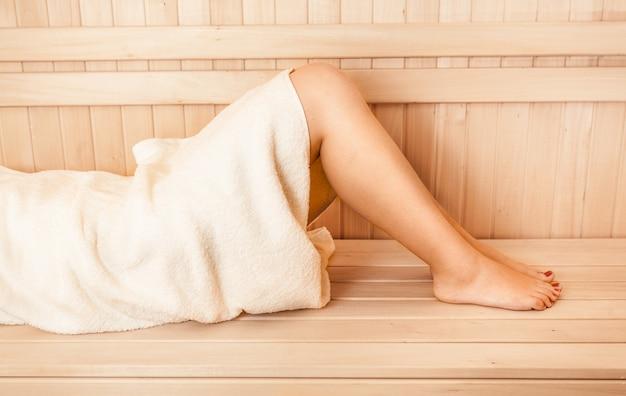 Closeup photo of women legs at sauna