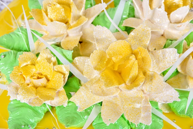 Closeup photo of the yellow wedding cake