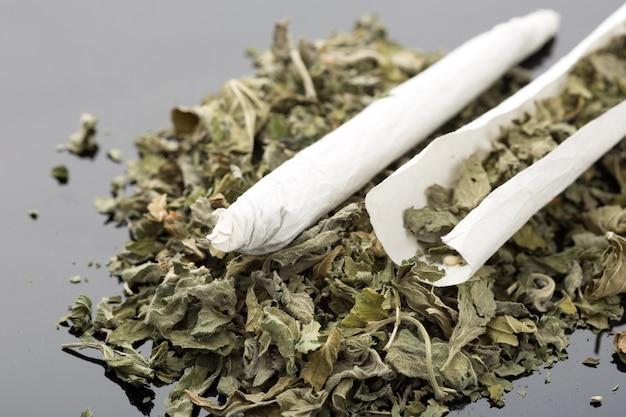 Closeup picture of handmade cigarette with dried marijuana