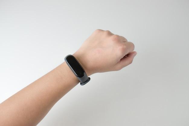 Closeup pictures of women wearing digital smart watches