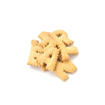 Closeup pile of brown biscuit in english alphabet isolated on white background