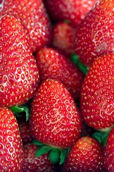 Closeup of pile of ripe strawberries