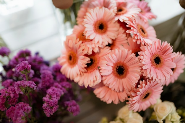 Closeup of pink gerber daisy bouquet and purple statice