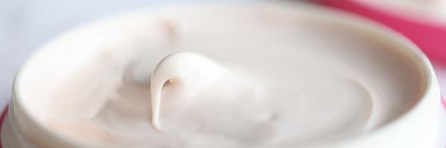 Closeup of pink jar of moisturizing cream