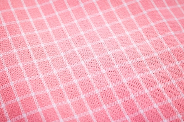 Closeup of pink tablecloth background. detail of fabric in picnic pattern.